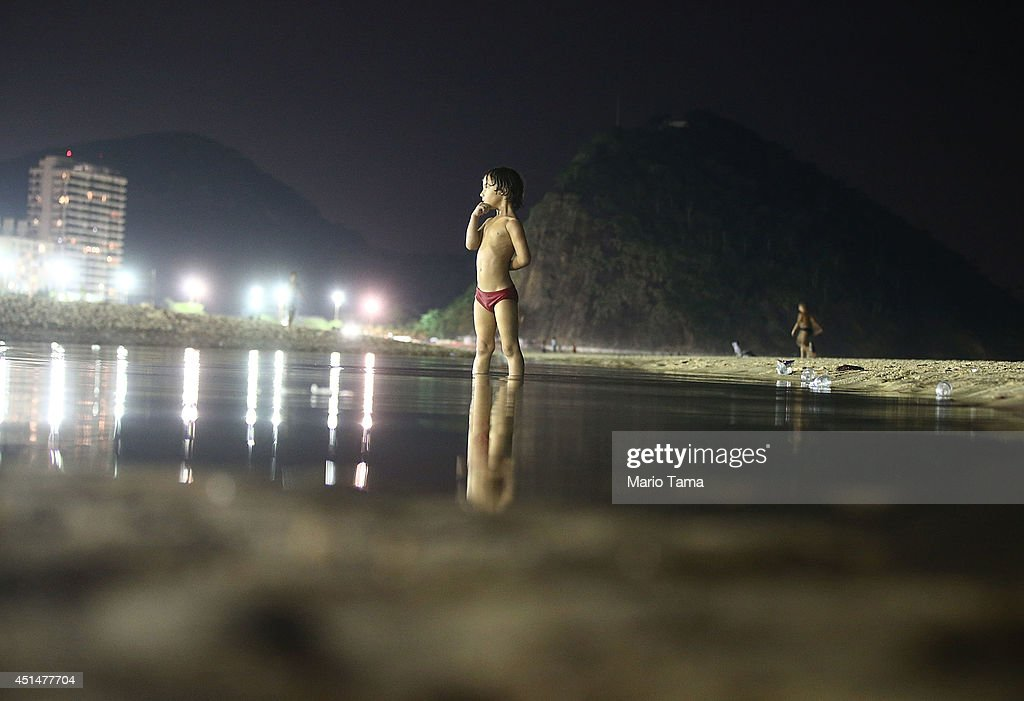 A boy stands outside the FIFA Fan Fest live broadcast of the Costa Rica-Greece match on Copacabana Beach on June June 29, 2014 in Rio de Janeiro, Brazil. Costa Rica won the dramatic match despite playing with only ten men for part of the second half.