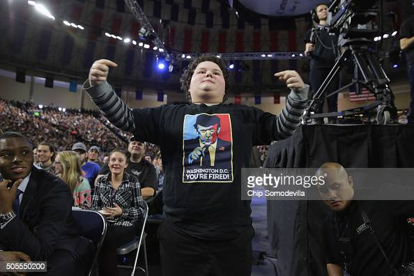 A boy stands up to cheer for Republican presidential candidate Donald Trump as he delivers the convocation at the Vines Center on the campus of...
