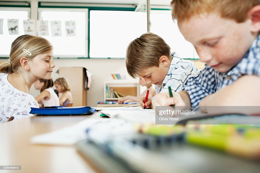 Boy studying in classroom : Stockfoto