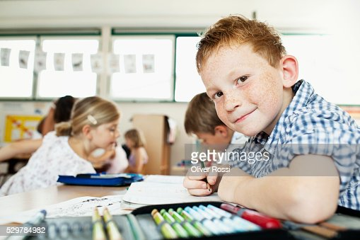 Boy studying in classroom : Stock Photo