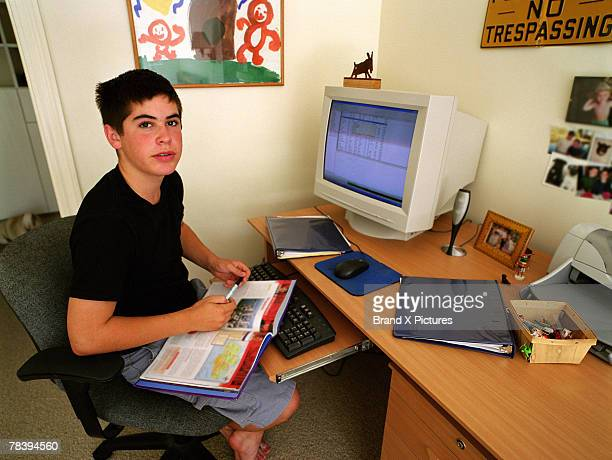 Boy studying on the computer