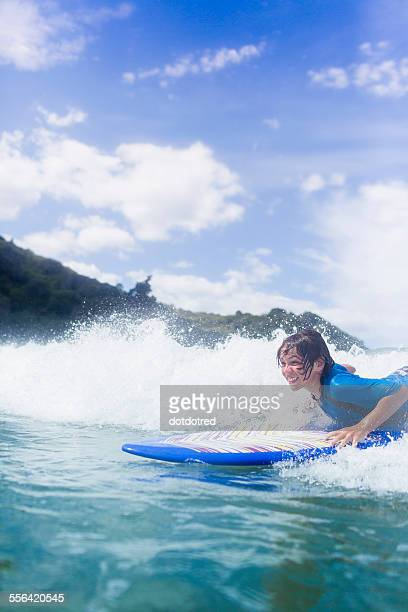 Boy surfer riding the wave