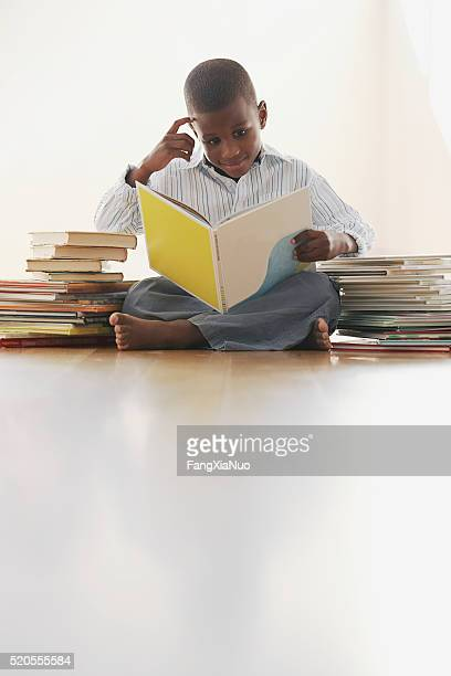 Boy surrounded by storybooks