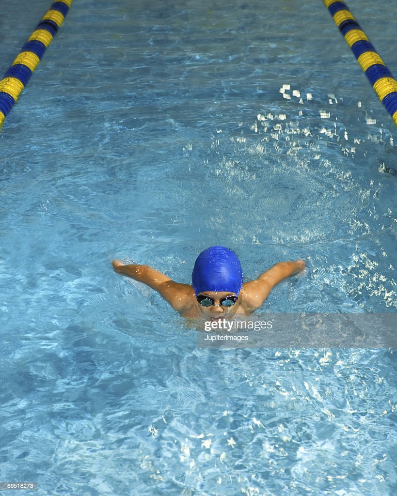 Boy swimming the butterfly stroke : Stock Photo