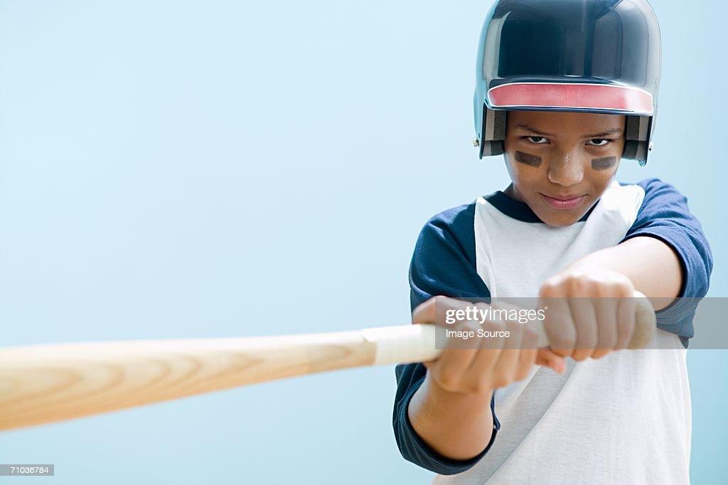 Boy swinging baseball bat