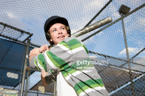 Boy Swinging Baseball in Batting Cage