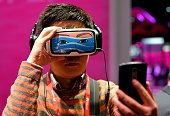 A boy takes a selfie photo as he tests the 'Oculus VR' virtual device at the stand of Deutsche Telekom during the Mobile World Congress in Barcelona...