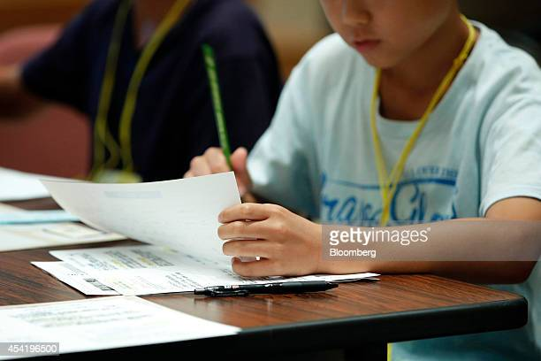 A boy takes part in a parentandchild investment class hosted by Japan Exchange Group Inc at the Tokyo Stock Exchange in Tokyo Japan on Monday Aug 4...