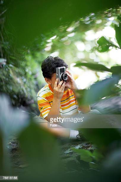 Boy Taking a Picture in the Woods