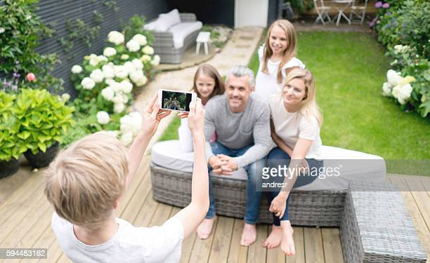 Boy taking a picture of his family