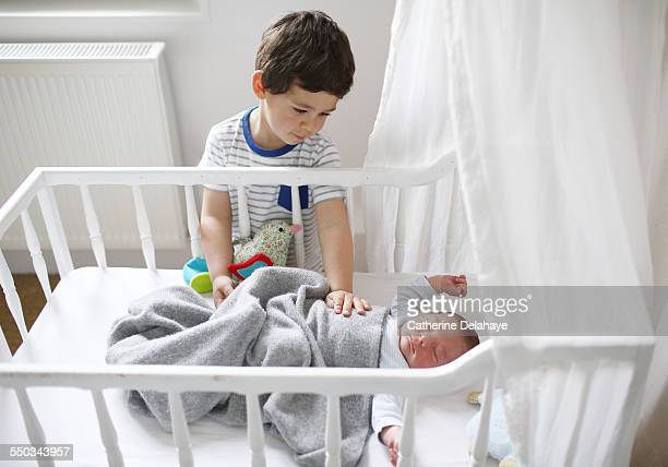 A boy taking care of his baby brother