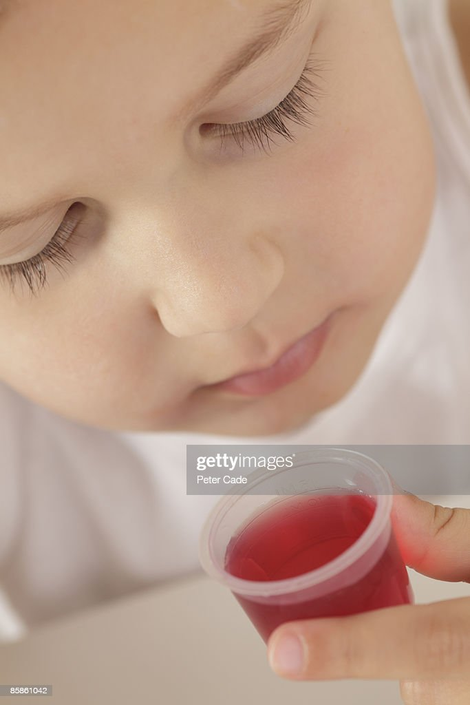 Boy taking medicine : Stock Photo