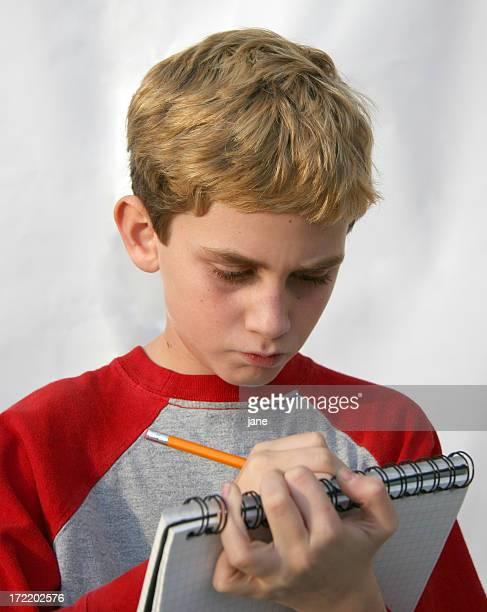 Boy Taking Notes