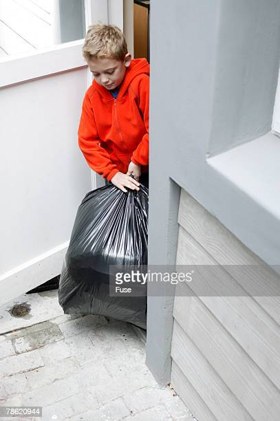 Boy Taking Out Trash