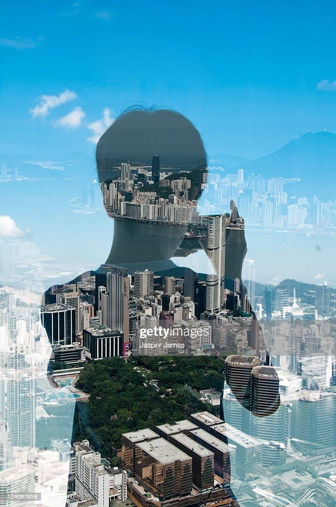 boy taking photo of Hong Kong Harbour : Stock Photo