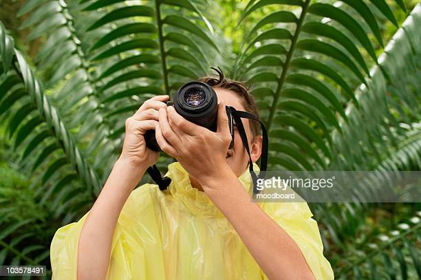 Boy Taking Photos in Forest