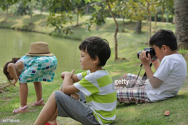 Boy taking picture of a girl making funny pose