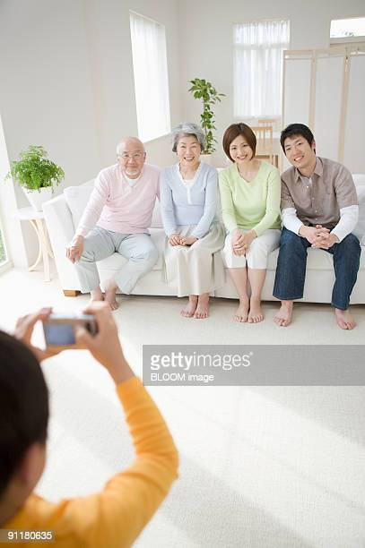 Boy taking picture of parents and grandparents