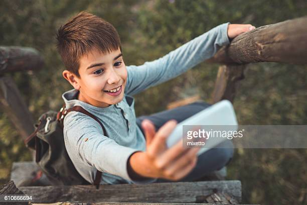Boy taking selfie
