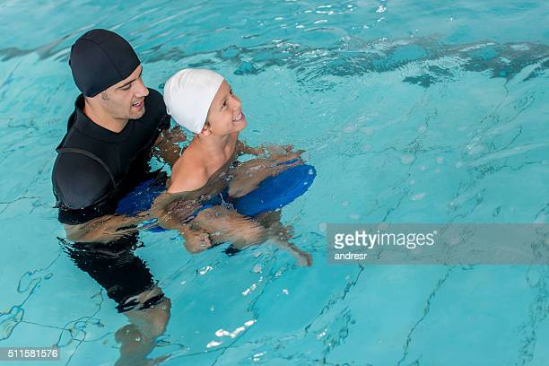 Boy taking swimming lessons