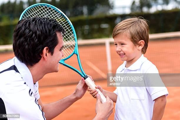 Boy taking tennis lessons