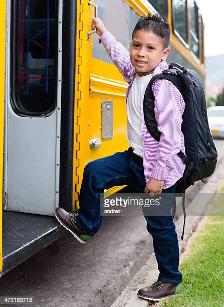 Boy taking the bus to school