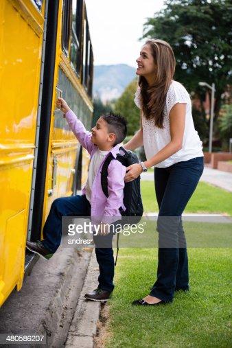 Boy taking the school bus
