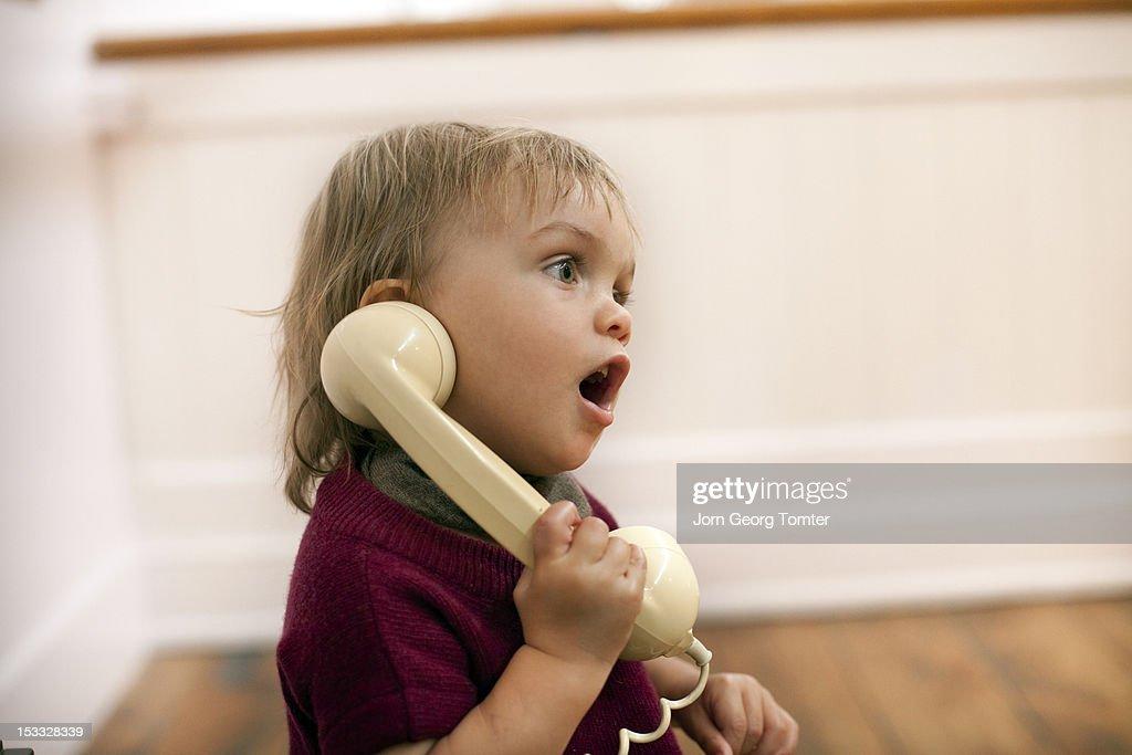 Boy talking on old fashioned telephone : Stock Photo