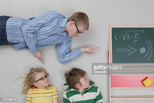 Boy teaching speed of sound to children