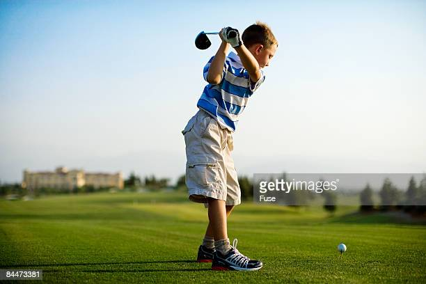 Boy Teeing Off
