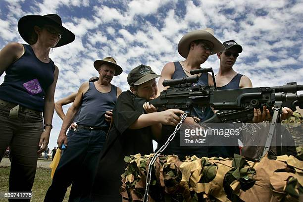 A boy tests out weapons on display provided by the Australian Army at the Deniliquin ute muster 1 October 2005 THE AGE Picture by ANGELA WYLIE