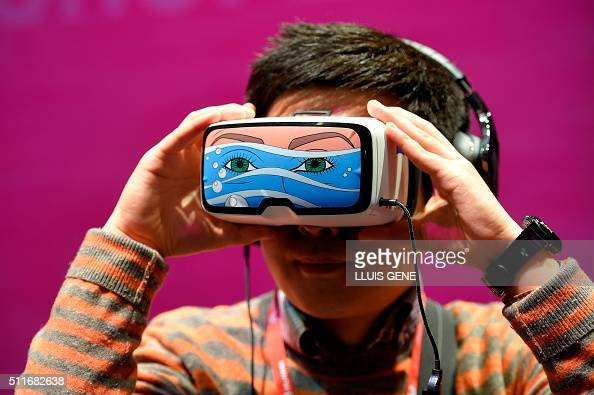 TOPSHOT A boy tests the 'Oculus VR' virtual device at the stand of Deutsche Telekom during the Mobile World Congress in Barcelona on February 22...