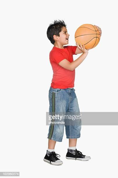 Boy throwing a basketball