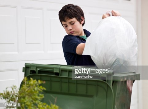 Boy throwing out the garbage