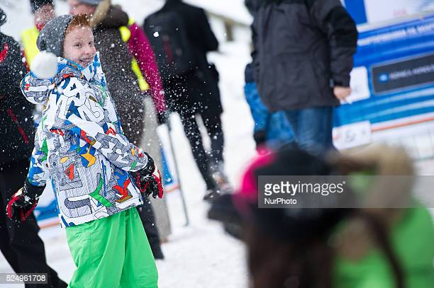 A boy throws a snowball during the Large Hill Individual competition on day two of the FIS Ski Jumping World Cup on February 8 2015 in Titisee Germany