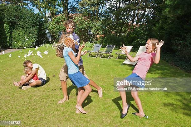 Boy throws at girl a cream cake as a joke