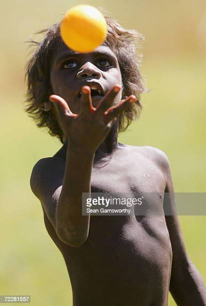 A boy tosses a ball during a Cricket Australia tour of Indigenous communities in the Northern Territory June 20 2004 in Katherine Australia