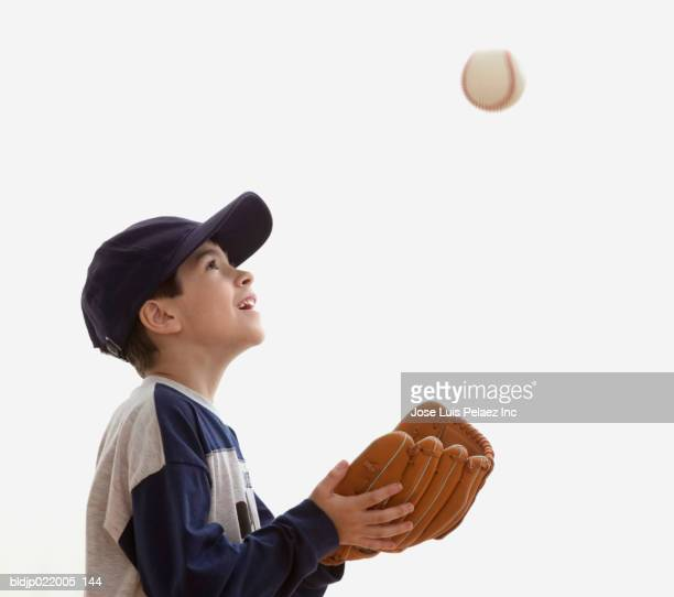 Boy tossing a ball