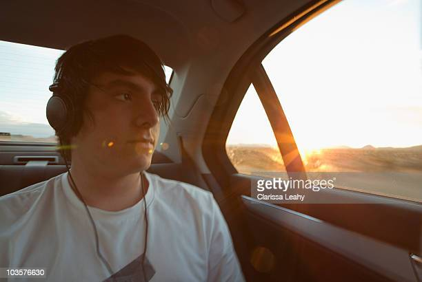 Boy traveling in back seat of car