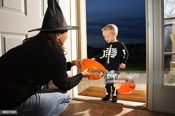 Boy trick or treating on Halloween