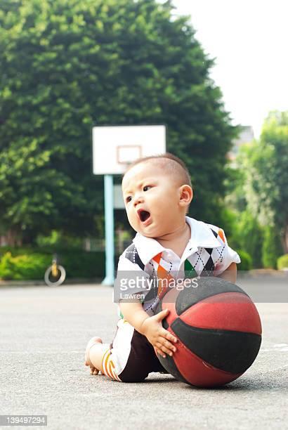 Boy tries to take basketball