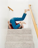 Boy (11-13) tumbling on stairs, side view