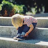 Boy tying shoelaces