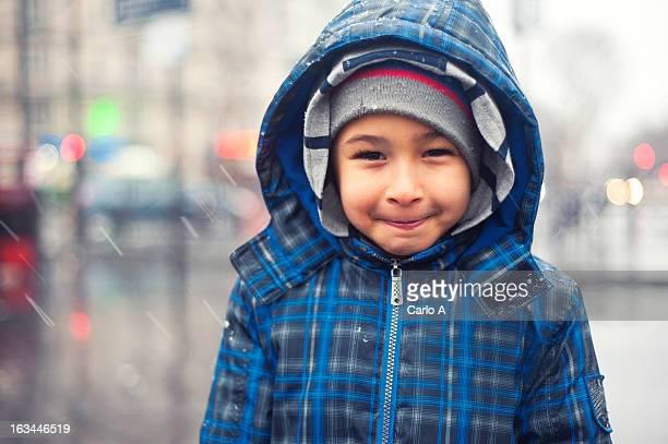 Boy under rain