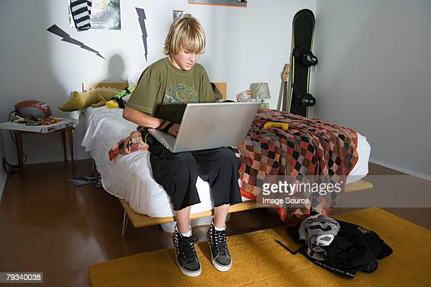 A boy using a laptop