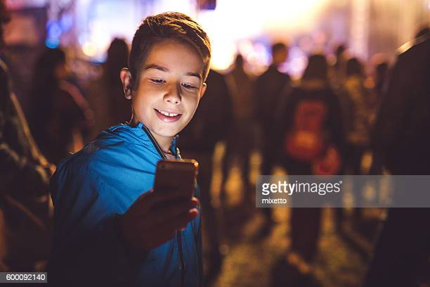 Boy using a mobile phone at night