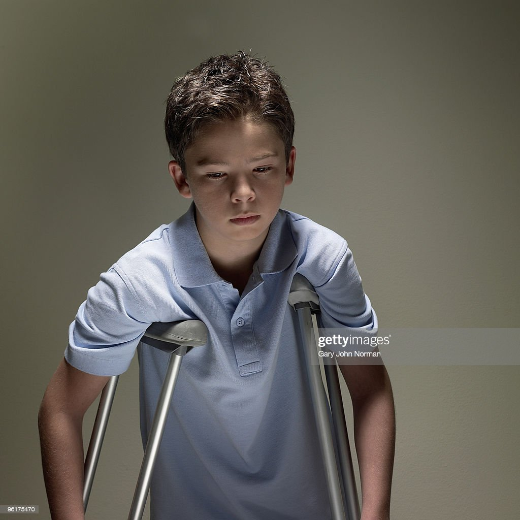 Boy using crutches for support