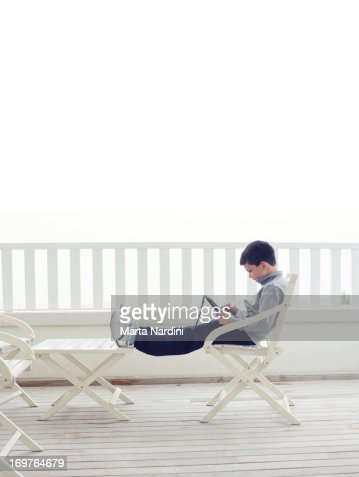 Boy using digital tablet device : Stock Photo