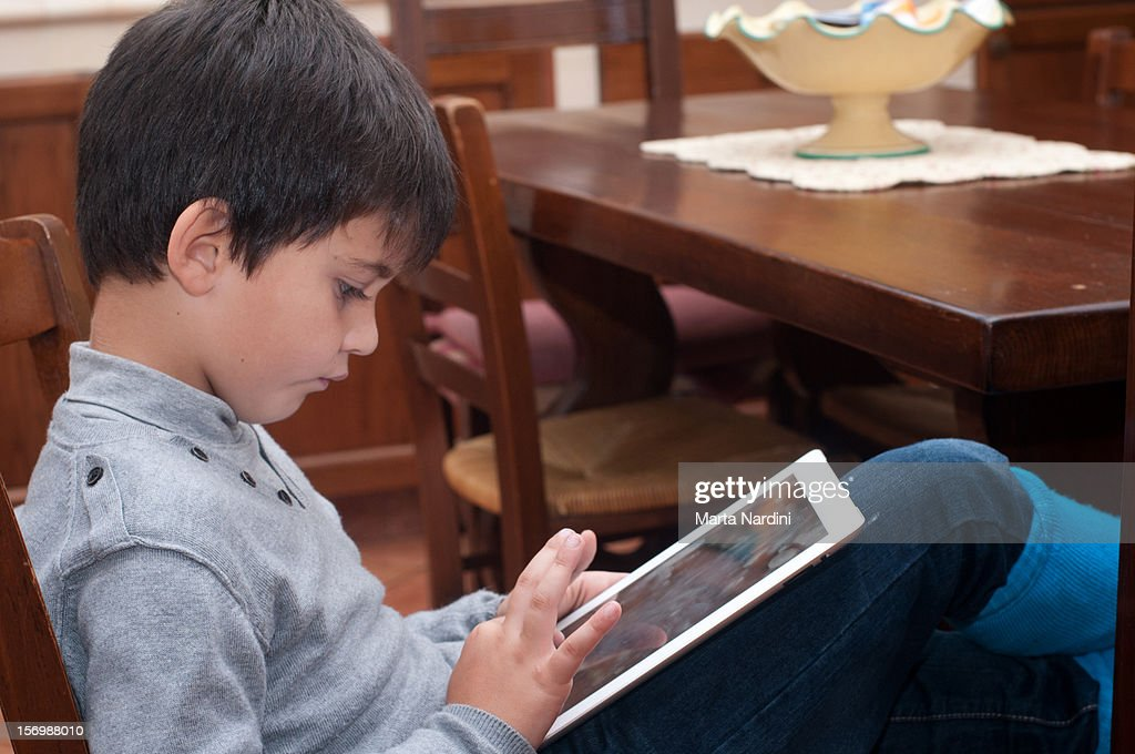 Boy using digital tablet : Stock Photo