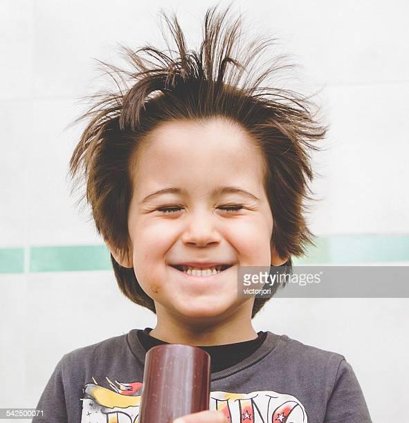 Boy (4-5) using hairdryer